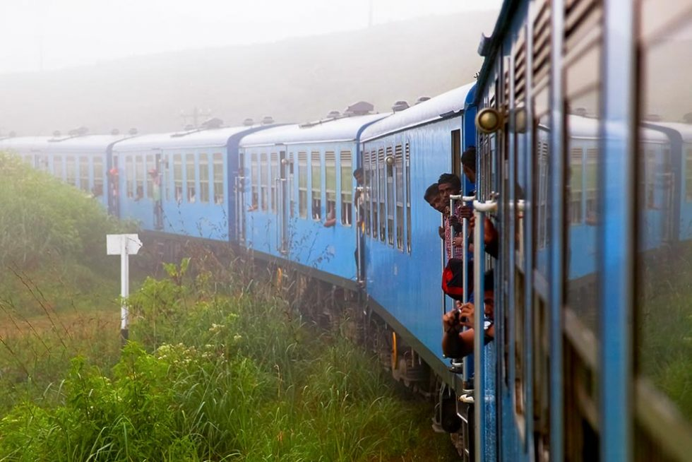Train passing near the town of Nuwara Eliya, Sri Lanka | Happymind Travels