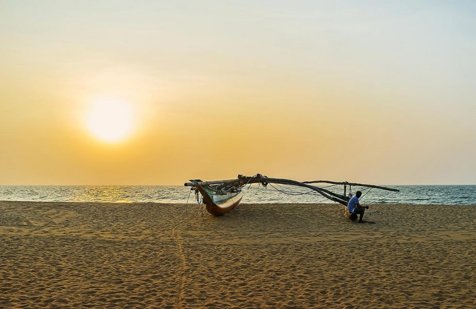 Beautiful landscape in mid March - Catamaran on Negombo beach   Happymind Travels