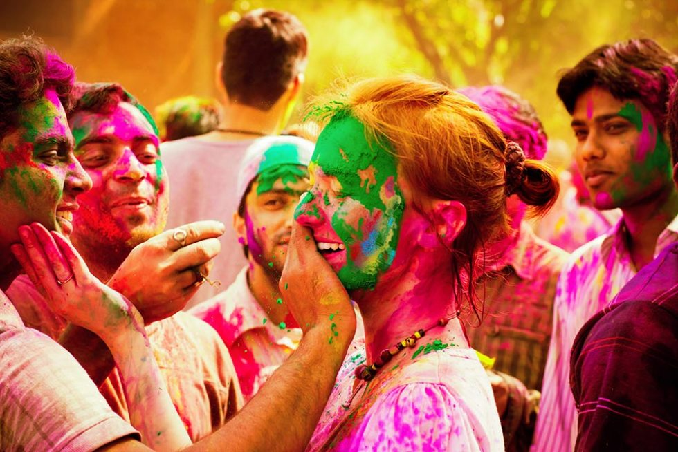 Woman to be painted during the Holi Festival in Delhi India | Happymind Travels