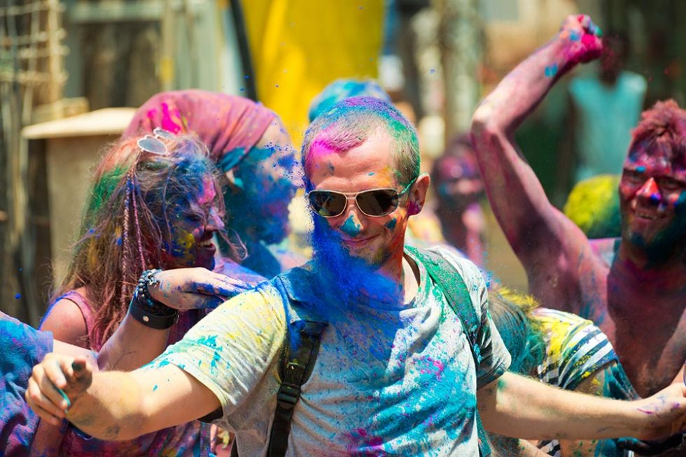 Travelers during the Holi Festival in Hampi I-land, India | Happymind Travels