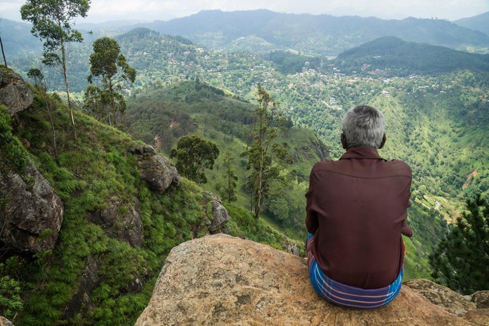 On top of Ella Rock with a local enjoying the view | Happymind Travels