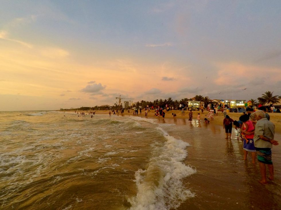 Locals and tourists on the beach of Negombo, Sri Lanka waiting for the sunset   Happymind Travels