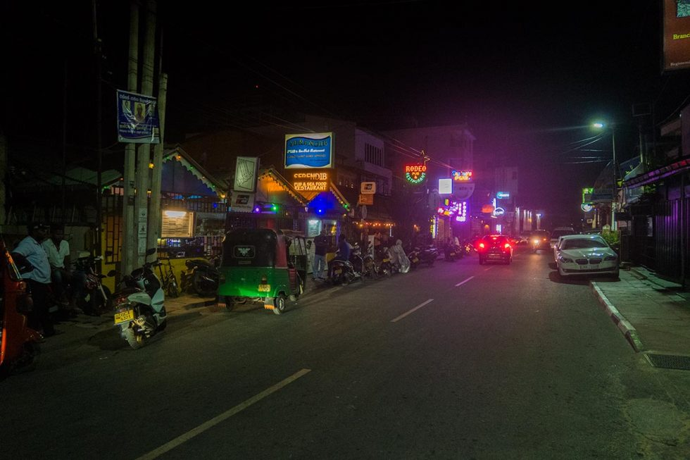 Main Street in Negombo at night with the Rodeo Bar on the sight   Happymind Travels