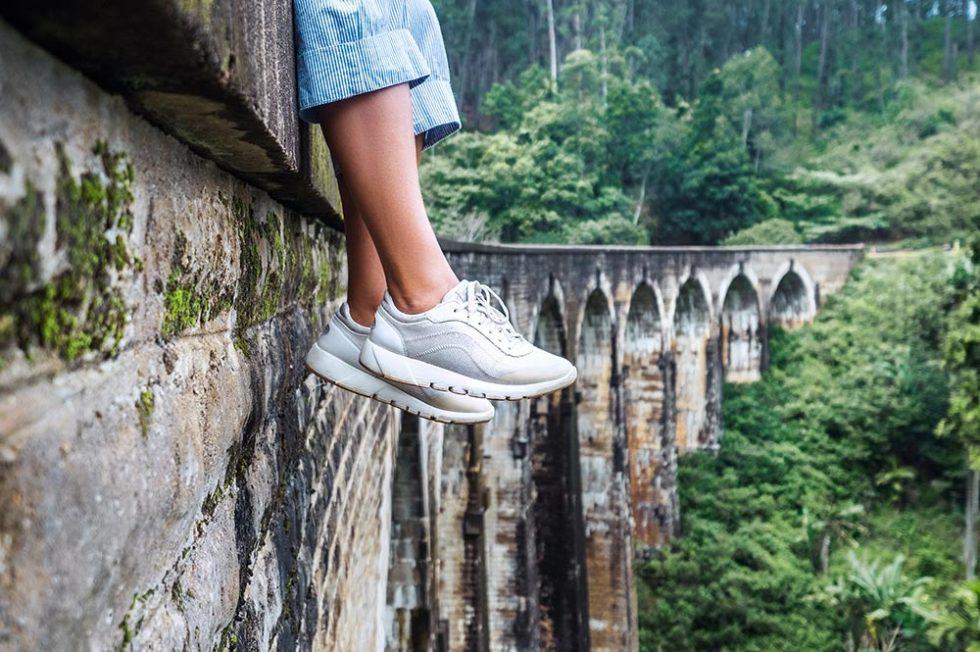Sitting at the Nine Arches Bridge in Ella, Sri Lanka waiting for the train | Happymind Travels
