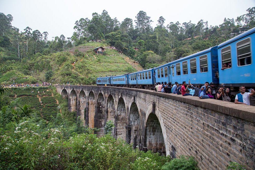 Nine Arches Bridge in Ella, Sri Lanka with the train passing | Happymind Travels