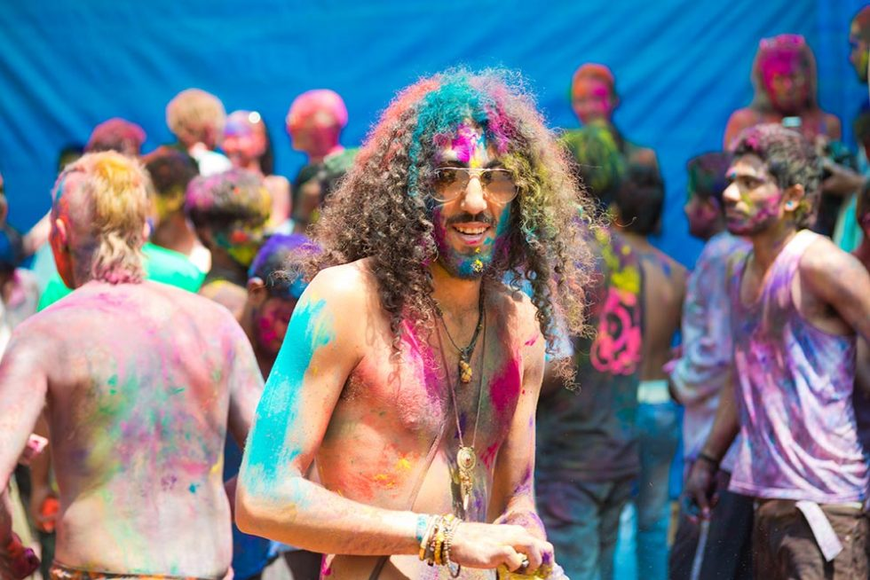 Brightly colored traveler during the Holi Festival in India | Happymind Travels