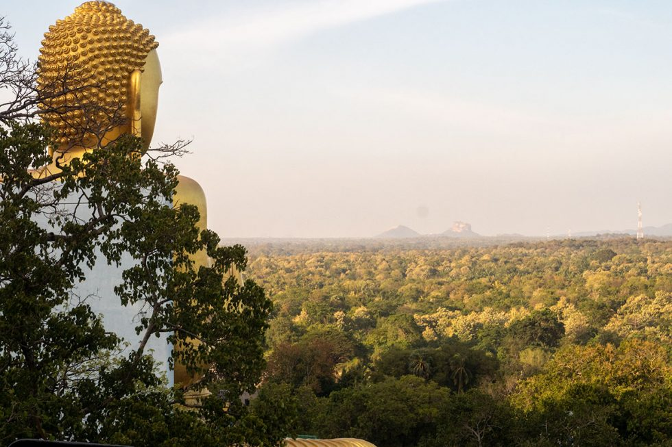 View of Sigiriya Palace in the distance, from the Dambulla Caves, Sri Lanka - Happymind Travels