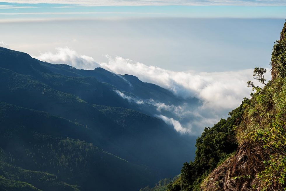 The View at World's End with clouds rising and covering the landscape in Horton Plains, Sri Lanka | Happymind Travels